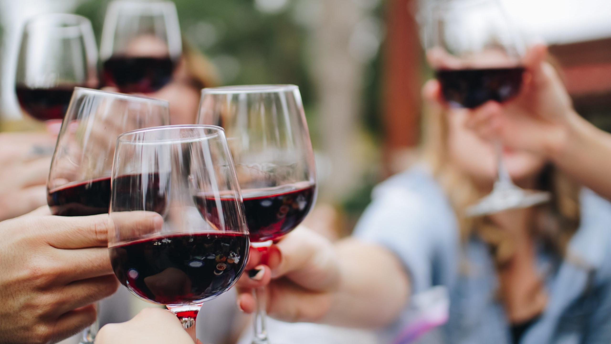 red wine cheersing
